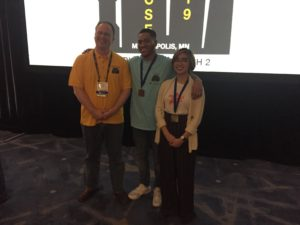 CS Junior Shm Almeda with two other people at the ACM Student Research Contest